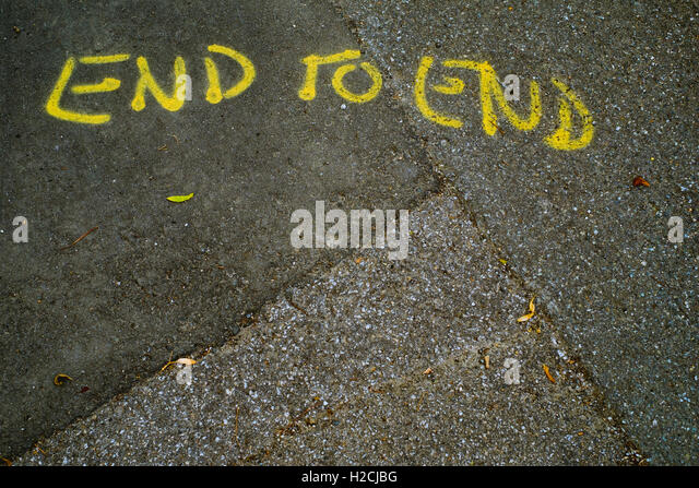 End To End - graffiti on the pavement - Stock Image