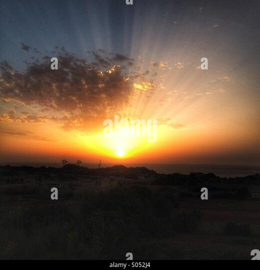 Sunrise looking towards Ramla bay, Gozo - Stock Image