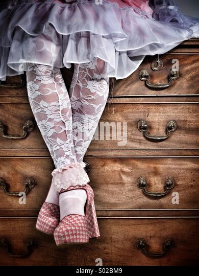 Fashion shoot - lacy stockings and ruffled skirt - Stock Image