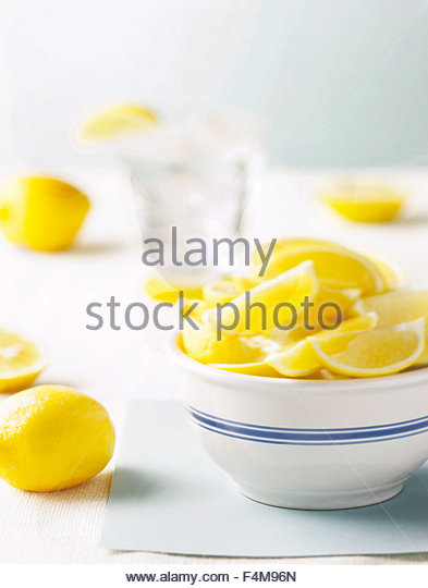 lemons in a bowl with water - Stock Image