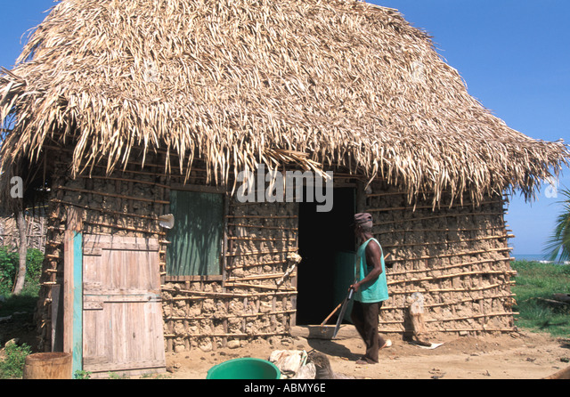 Honduras Central America Garifuna village thatch and mud home Sambo Creek Caribbean coast Horizontal - Stock Image