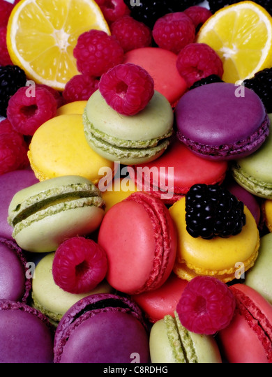 lemon, peach, strawberry, blackcurrant, pistachio, apricot and macaroons with lemon slices, raspberries and blackberries - Stock Image
