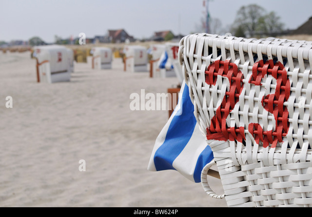 Beach chairs on the beach near Neustadt at Baltic Sea, Schleswig-Holstein, Germany - Stock Image