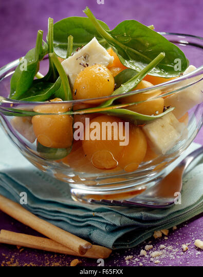 melon salad with gorgonzola and spinach shoots (topic: summer salads) - Stock Image