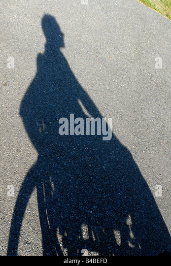 Shadow of a Man in a Wheelchair Copy Space - Stock Image