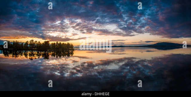Reflection on lake at dawn, Arjeplog, Lapland, Sweden - Stock Image