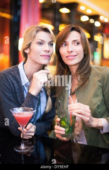 Women having cocktail at bar - Stock Image