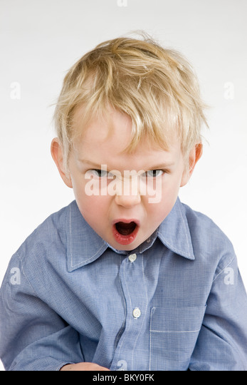 toddler angry boy screaming - Stock Image