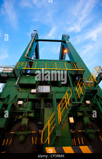 Low angle view of machinery at a shipping port - Stock Image