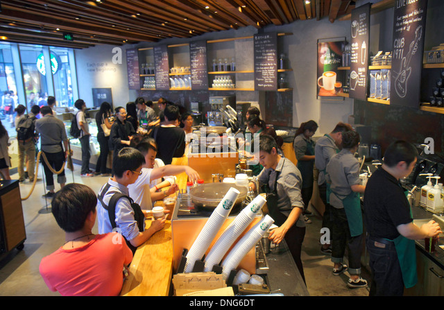 Beijing China Chaoyang District Sanlitun Village South North Piazza Deck shopping mall center centre Starbucks Coffee - Stock Image
