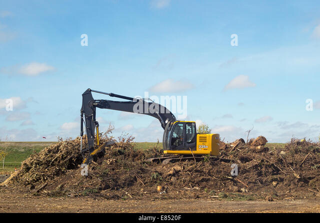 Windrow composting of trees for mulch at Shepard Waste Management Facility. - Stock Image