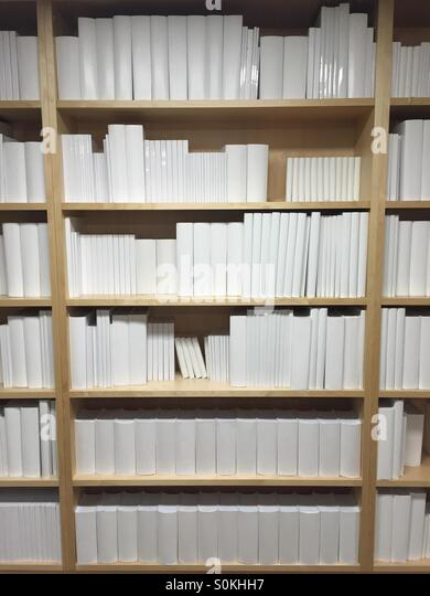 Plane white books on a shelf - Stock Image