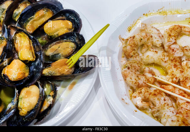 Spain Europe Spanish Hispanic Madrid Centro Mercado de San Miguel market shopping mussels shrimp scampi food - Stock Image