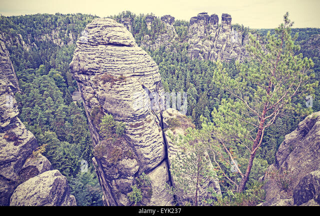 Vintage style rock formation in Bastei, Saxon Switzerland, Germany. - Stock Image