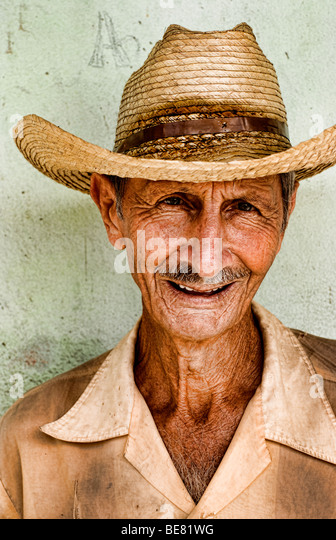 Portrait of local man against green wall in Cienfurgos Cuba - Stock Image