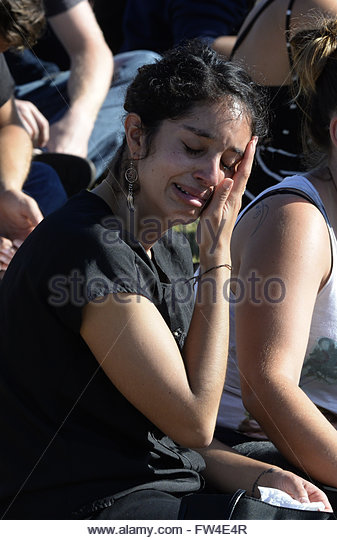 A student cries during a memorial event for the six UCSB students killed and 13 wounded in a shooting rampage in - Stock Image