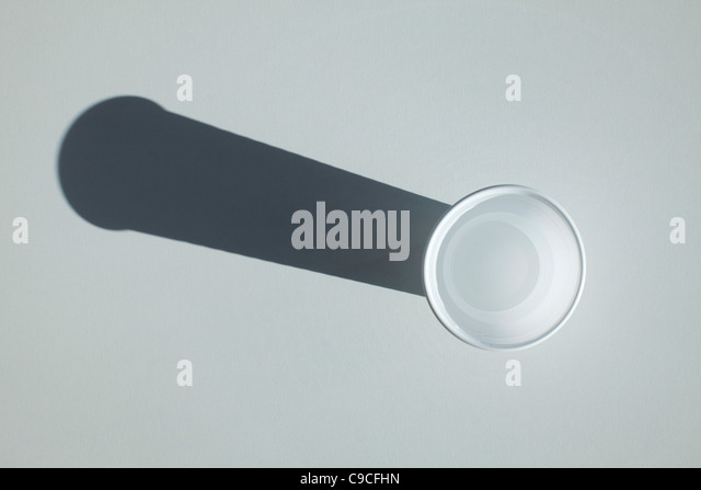 Cup and shadow, directly above - Stock Image