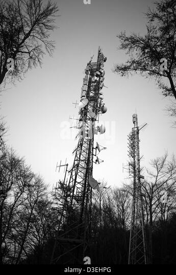 Satellite dishes tower in a wooden - Stock Image