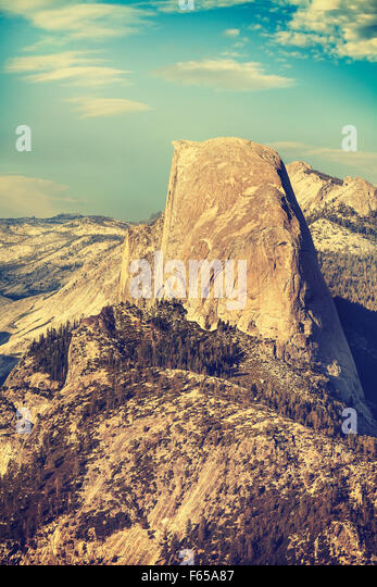 Old film retro toned Half Dome rock formation, Yosemite National Park, USA. - Stock Image