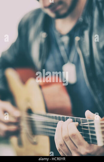 Man playing a guitar - Stock Image