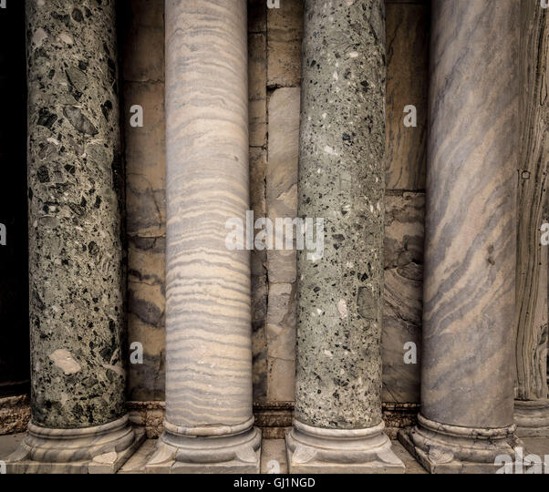 Polychrome marble columns  on the exterior portals of St Mark's basilica, Venice, Italy. - Stock Image