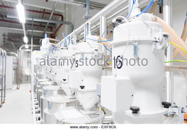 Equipment in a row in factory - Stock Image