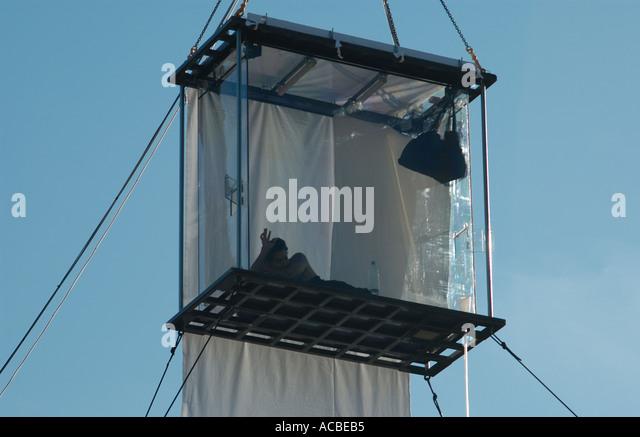 David Blaine in a glass box London England UK - Stock Image