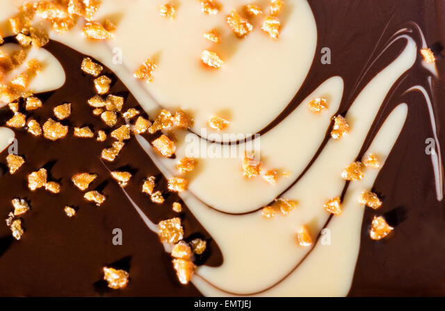 exclusive two-tone chocolate happy with caramel and white chocolate dark chocolate studio light tastes savory Still - Stock Image