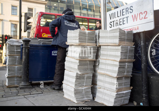Man selling Evening Standard newspaper Villiers Street, London WC2 - Stock Image