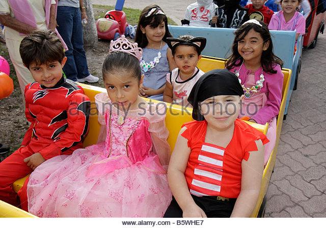Miami Florida Little Havana Jose Marti Park Halloween Festival Hispanic girls boys children pink princess costume - Stock Image