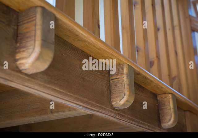 Close up of wooden bannisters on a staircase in a recently converted barn in rural England. - Stock-Bilder