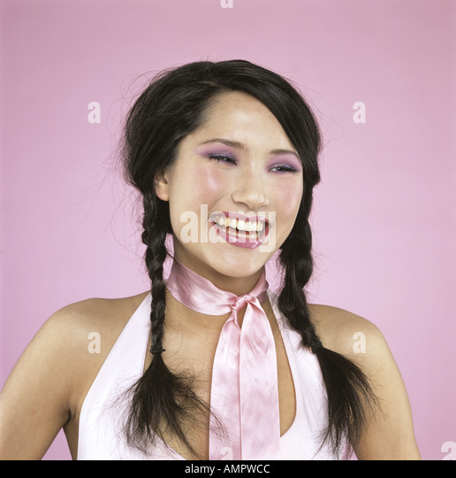 Young woman laughing, close-up - Stock Image