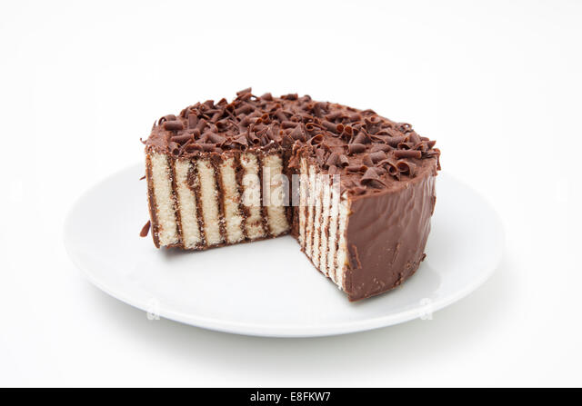 Chocolate layer cake on a plate - Stock Image