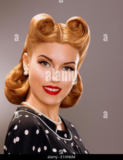 Nostalgia. Styled Smiling Woman with Retro Golden Hair Style. Nobility - Stock Image