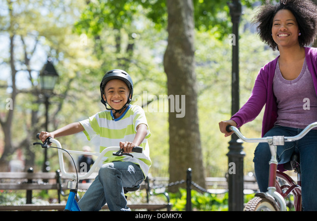 A family in the park on a sunny day. A mother and son. - Stock-Bilder