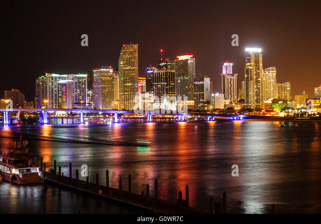 Colorful Miami skyline by night - Stock Image