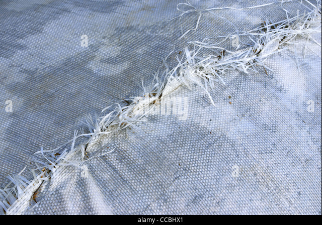White fabric with a seam. - Stock Image