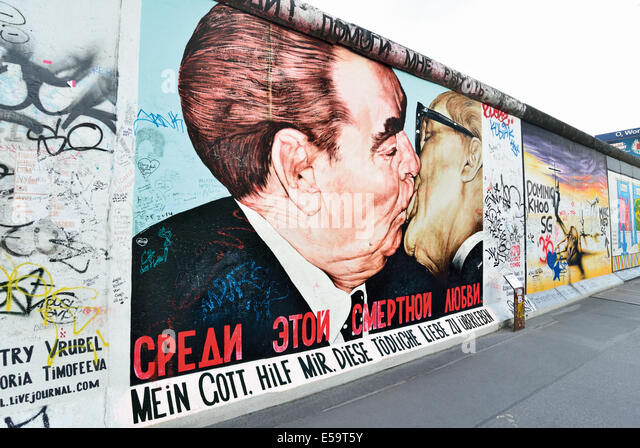 Germany, Berlin: Famous  'Brother kiss' at the former wall and actural East Side Gallery - Stock Image