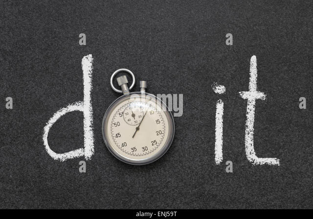 do it phrase handwritten on chalkboard with vintage precise stopwatch used instead of O - Stock Image