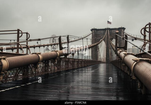 View of walkway on Brooklyn Bridge, New York, USA - Stock Image