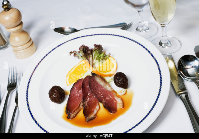 High angle view of bacon with gravy on a plate - Stock-Bilder