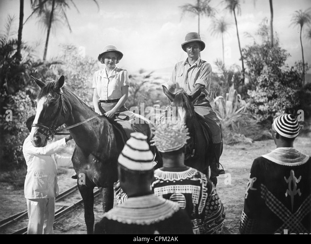 Europeans in Africa in a movie in the 1930's - Stock Image