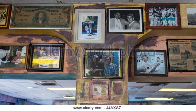 Symbols of the Cuban exiles and immigrants nostalgia in Little Havana's 'Calle Ocho'. Old photos decorating - Stock-Bilder