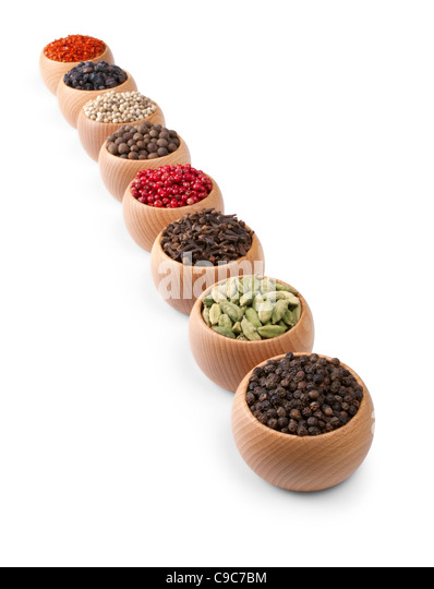 Wooden bowls full of different spices and herbs - Stock Image