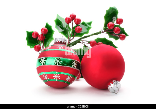 Christmas holly with decorative balls - Stock Image