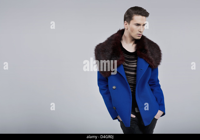 Handsome guy dressed in spring fashion coat - Stock Image