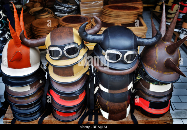 Quirky leather covered crash helmets, Sanur, Denpasar, Bali, Indonesia, Southeast Asia - Stock Image