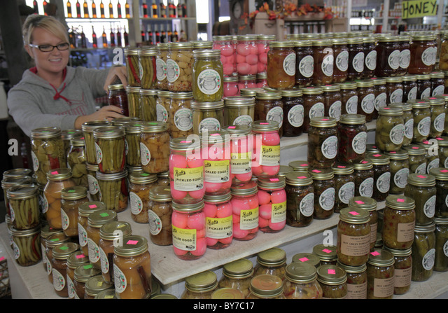 Georgia Robertstown produce stand farmers market local products pickled vegetables eggs preserve glass jar display - Stock Image