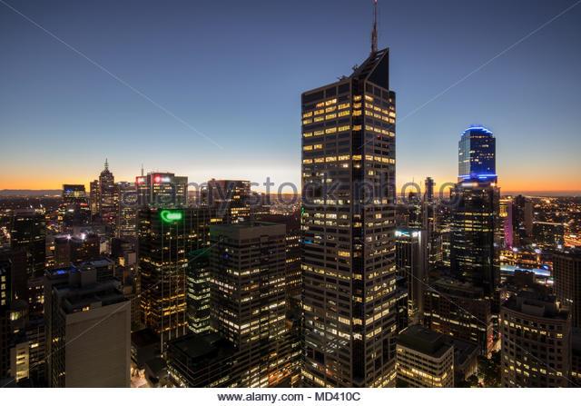Skyscrapers illuminated at sunset, Melbourne, Victoria, Australia - Stock Image