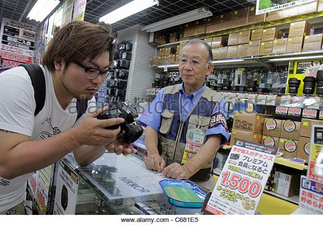 Tokyo Japan Shinjuku Yodobashi Camera Store shopping kanji hiragana katakana characters symbols Japanese English - Stock Image